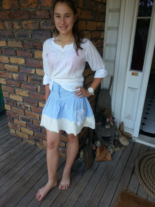 Ellie wears upcycled skirt