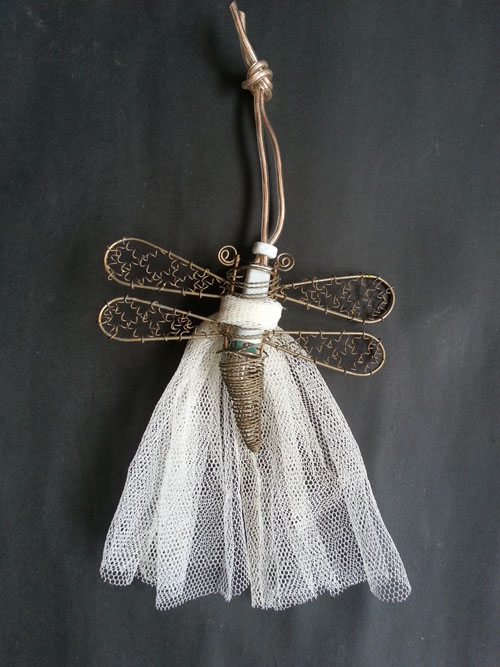 Old dragonfly lights upcycled as Christmas decorations